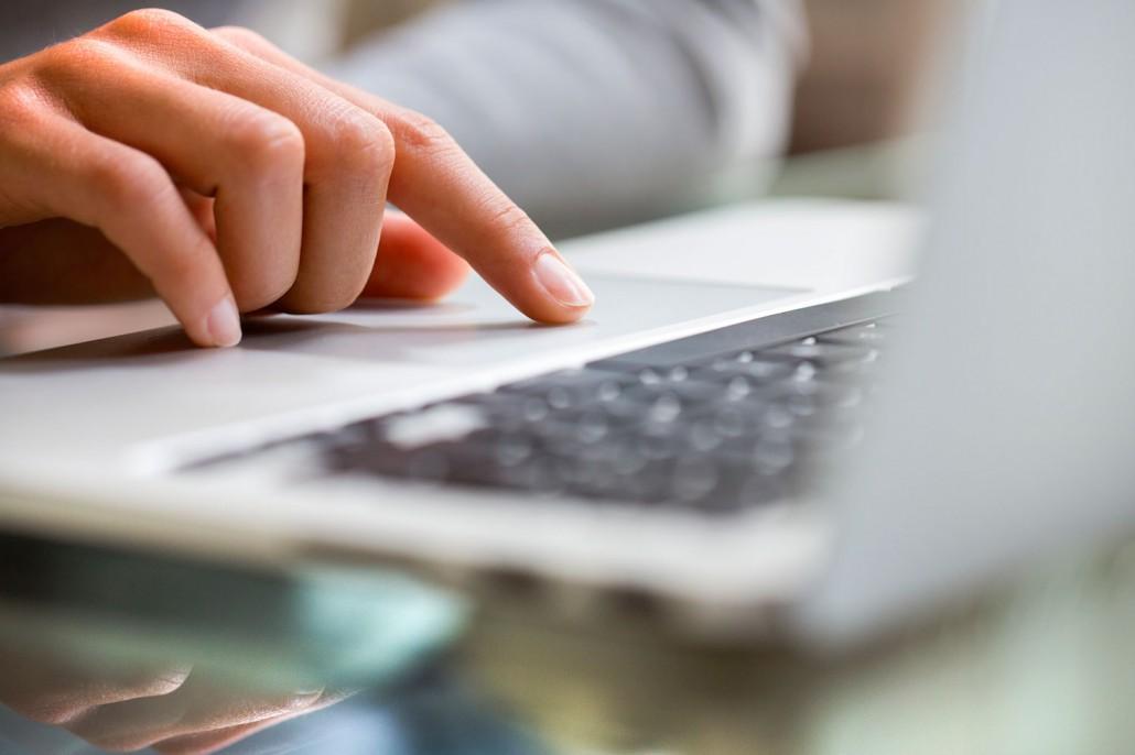 Qvera - man on laptop